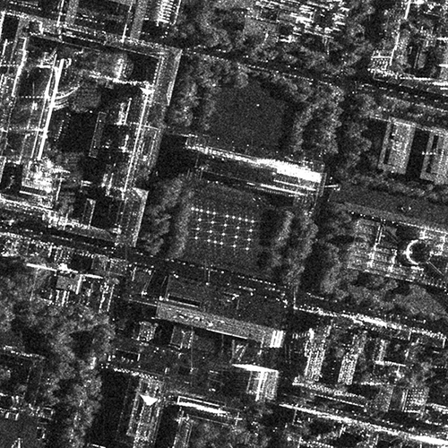 A black and white satellite image of the Museum Quarter in Munich, on which a TUM logo made up of small points of light can be seen.