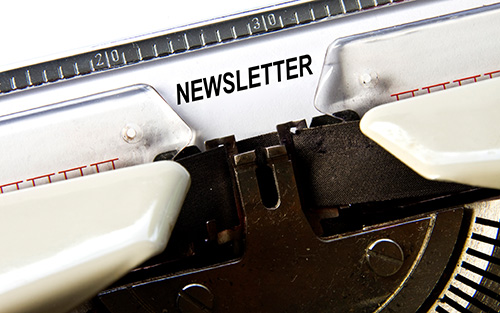 The word Newsletter written on a sheet in a typewriter.