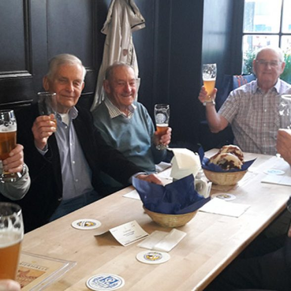 Civil engineers with beer at their alumni meeting