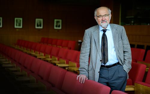 Portrait of Alumnus Erwin Neher in a theatre hall.