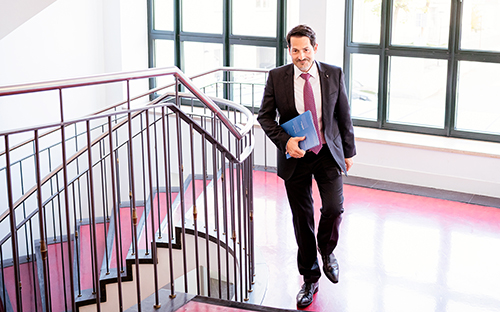 The president walks up a flight of stairs.